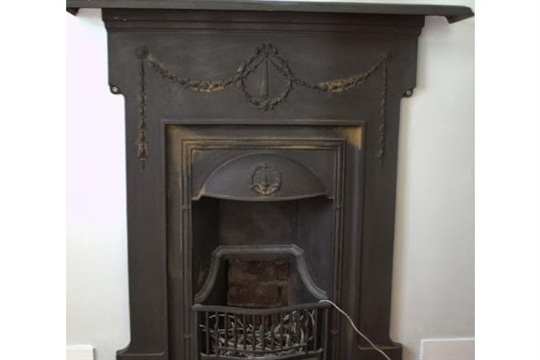 How to Remove rust from a cast iron fireplace