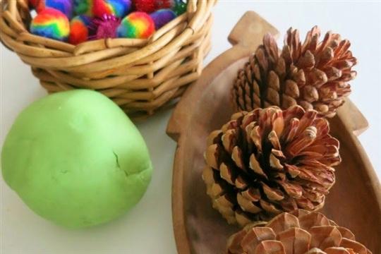 Invitation to Play. Pinecones, playdough and pompoms